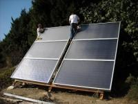 Chauffage solaire WAGNER & Co installé sur un support en bois au sol. Latrape (31)