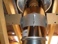 Traversée de toiture d'un conduit de fumées inox double paroi isolé pour poêle à bois. Eaunes (31).