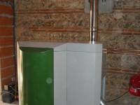 Chaudière bois granulés à vis OKOFEN 23kW pour chauffage central et eau chaude sanitaire. Saverdun (09).