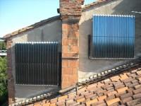 Chauffage solaire CONSOLAR avec capteurs tubes sous vide installés en façade .Carbonne (31)