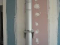 Création d'un conduit de fumées inox double paroi isolé pour poêle à granulés en maison BBC-RT2012. Montesquieu Volvestre (31).