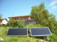 Chauffage solaire  WAGNER & Co en appoint d'un poêle à bois pour chauffage central. Gaillac-Toulza (31)