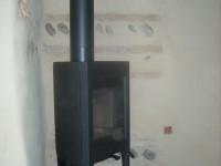Poêle à bois JOTUL F162 de 9kW + création d'un conduit de fumées double paroi isolé. Poucharramet (31)