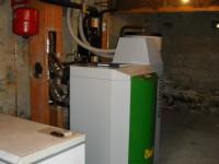 Chaudière bois granulés à aspiration OKOFEN 23kW pour chauffage central et eau chaude sanitaire. Capens (31).