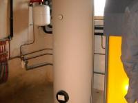 Chaudière bois bûches ETA SH 40kW pour chauffage central et eau chaude sanitaire (ballon 300L double échangeur). Anan (31).