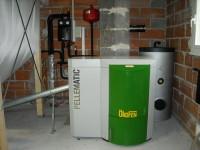 Chaudière bois granulés à vis OKOFEN 12kW pour chauffage central et eau chaude sanitaire (ballon 200L double échangeur). Gensac sur Garonne (31).