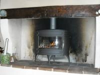 Poêle à bois INVICTA Mandor de 12kW + tubage d'un conduit de fumées existant. Rieux-Volvestre (31)