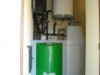 Chaudière bois granulés à aspiration OKOFEN 10kW pour chauffage central et eau chaude sanitaire. Frouzins (31).