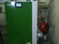Chaudière à granulés Pellematic COMPACT de 16kW pour chauffage en rénovation. Trémie à alimentation manuelle de 180kg à Cazères (31)