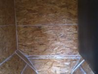 Vue intérieure d'un silo bâti. Vis sans fin et tapis pare-impact à Poucharramet (31)
